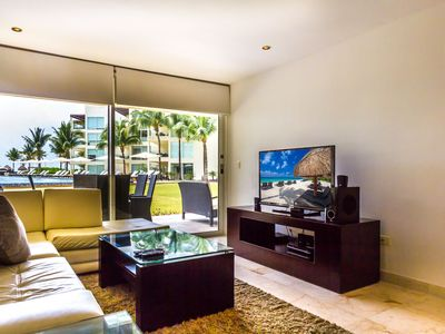 Photo for 2 Bedroom condo directly off the huge pool at The Elements by BRIC