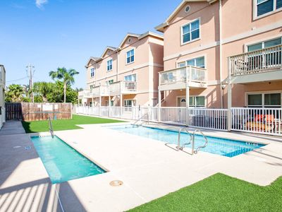 Photo for NEW LISTING! Cozy condo w/shared pool & hot tub - great location walk to beach