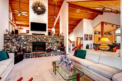 Great Room (main level) - Open, spacious - cathedral ceilings, exposed beautiful beams, skylights, large windows and comfy furnishings, grand stone hearth fireplace!