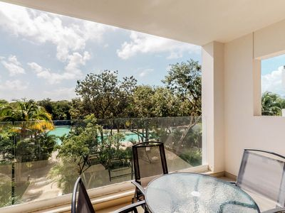 Photo for NEW LISTING! Beautiful condo w/great views from balcony, shared pool- near beach