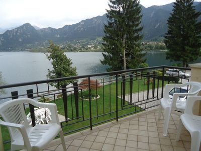 Photo for large apartment directly on the lake to 7 people, pool, garden and great views