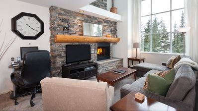 Cozy living room with presto log fireplace and flat screen TV.