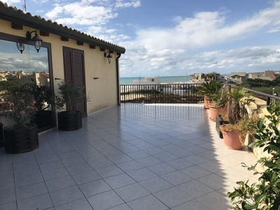 Photo for Large apartment with sea view terrace in Donnalucata
