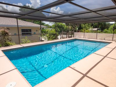 Photo for Beach house blocks from sand w/ private Pool & Lanai! Close to I-75