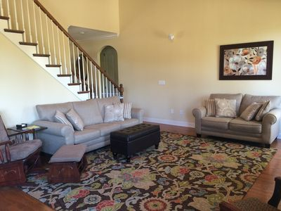 Large family room with large HDTV with surround sound with open floor plan.