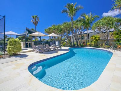 Photo for Holiday by the sea- heated pool, spa & full size tennis court.100m to surf beach