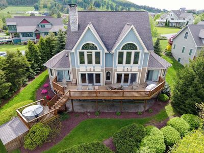 Dog friendly lakefront home with dock slip, fireplaces, pool table and a hot tub!