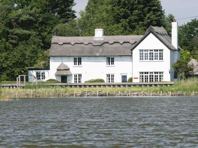 Photo for Beautiful Thatched Cottage Overlooking Hickling Broad