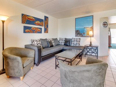 Photo for Contemporary condo w/ shared pool and full kitchen, steps from the beach
