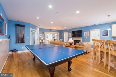 """One of 2 first floor family rooms with new 65"""" TV and Pool/Ping Pong table!"""