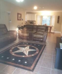 Living room with relaxing recliner couch and loveseat. The loveseat has an USB