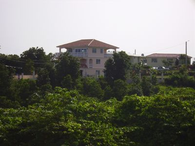 View of villa's three decks from the valley looking toward the ocean