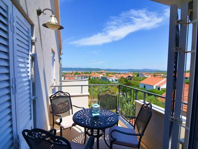Photo for Two bedroom apartment with terrace and sea view Murter (A-16655-d)
