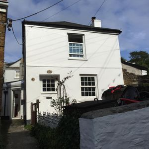 Photo for Detached character cottage in heart of old Polruan with sun terrace with view