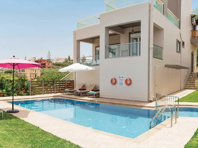 Photo for Stylish villa with private pool, surrounded by lawns & gardens, complete with BBQ & pergola