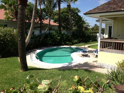 Our heated pool surrounded by palms, hibiscus, frangipani and our shell garden!