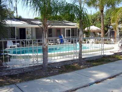 April and May specials 2BR, 1Ba, large pool walk to beac