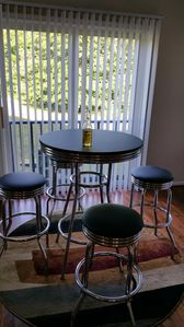 Bistro table for a quick meal in the kitchen with nice view of the backyard