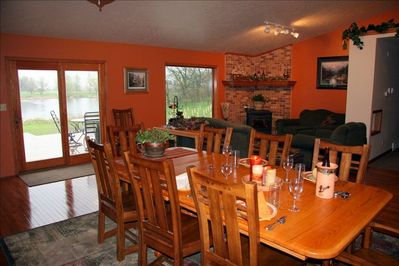 Enjoy meals in the great room overlooking the pond