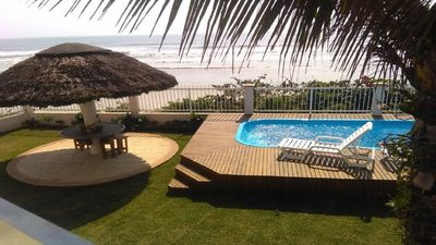 Photo for Beautiful beachfront home with pool and peh kiosk in the sand Porto Belo Pereque.