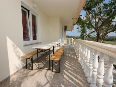 Photo for One bedroom apartment with terrace and sea view Povljana (Pag)
