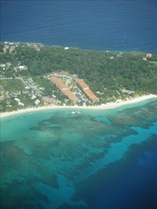 Aerial view of Infinity Bay showing reef at West Bay Beach.