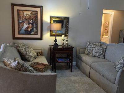 Beautiful living room - two large sofas and coffee table, open to kitchen