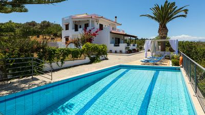 Outdoors area with swimming pool, sun beds, sun umbrellas and outdoor furniture!