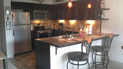 Newly reconstructed kitchen with stainless appliances and fully stocked