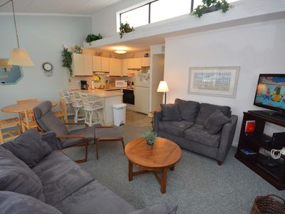 Photo for Cozy, suave 2-bedroom condo with free WiFi and a convenient midtown location only one block from the beach!