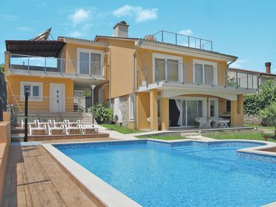 Photo for This 4-bedroom villa for up to 10 guests is located in Premantura and has a private swimming pool, a