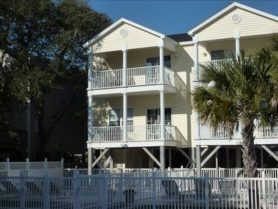 Front of Katy's Dream - 2 porches facing ocean with seating to enjoy view!