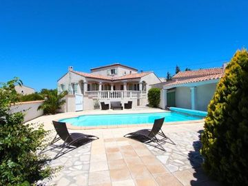 Exclusive luxury villa with private pool & landscaped gardens.