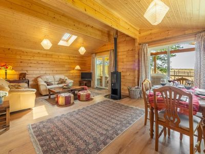 Photo for The spacious living area has a fabulous homely feel with a contemporary wood burner.