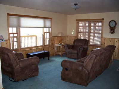 The main floor living room looks out onto the deck with a great view of the Park