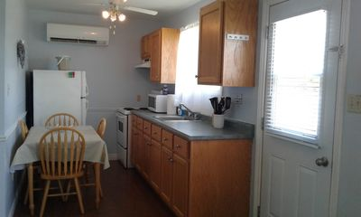Kitchen is freshly painted. It has new dishes, pots and pans.