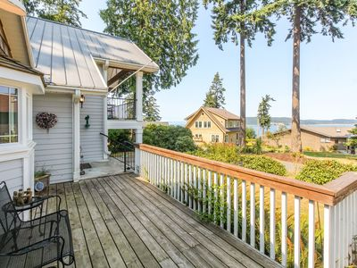 Photo for NEW LISTING! Spacious home with lush garden, nice bay views, peaceful location