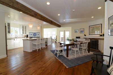 Open floor plan with chef's kitchen, table for 8 and 2 living rooms