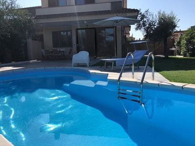 Photo for Villa with pool in a pretty village near the beautiful beach of Costa Rei