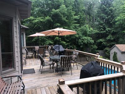 Deck with 2 seating areas and Weber Gas and Charcoal Grills