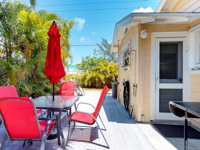 Photo for Sunny, dog-friendly cottage w/ a spacious patio and grill, steps from the beach!