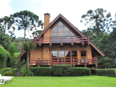 Photo for charming house in the midst of Campos do Jordao Mountains with tennis court.