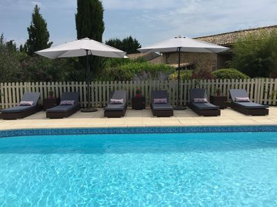 Photo for Lovely three bedroomed gite overlooking the pool close to the Gironde & beaches