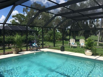 Photo for Renovated Golf Course Home near beautiful Florida beaches ,heated private pool