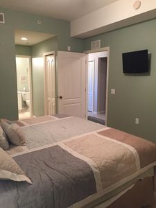The master bedroom has a king size bed with a walkin closet and ensuite bathroo