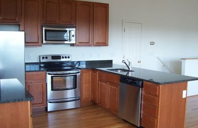 Granite counter top kitchen/stainless steel appliances.