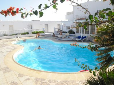Photo for Just 2 minutes from the big beach - 2 bedrooms 2 bathrooms balcony pool