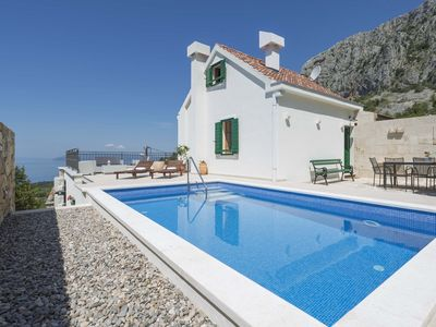 Photo for TOP OFFER-Charming cottage with heated pool in a quiet location and sea view