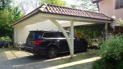 The carport parks two cars. There is one more parking in front of the house.