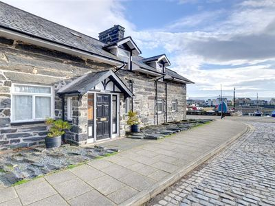 Photo for This apartment is on the ground floor of the old wharf masters house and is located alongside Porthm